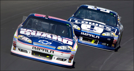 Dale Earnhardt Jr and Jimmie Johnson used pit strategy to put themselves at the front of the Pure Michigan 400 field at Michigan International Speedway. Photo: Geoff Burke/Getty Images for NASCAR