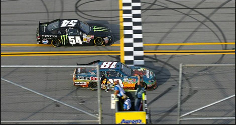 Joey Logano edging out in front of Kyle Busch (Photo: NASCAR.com)